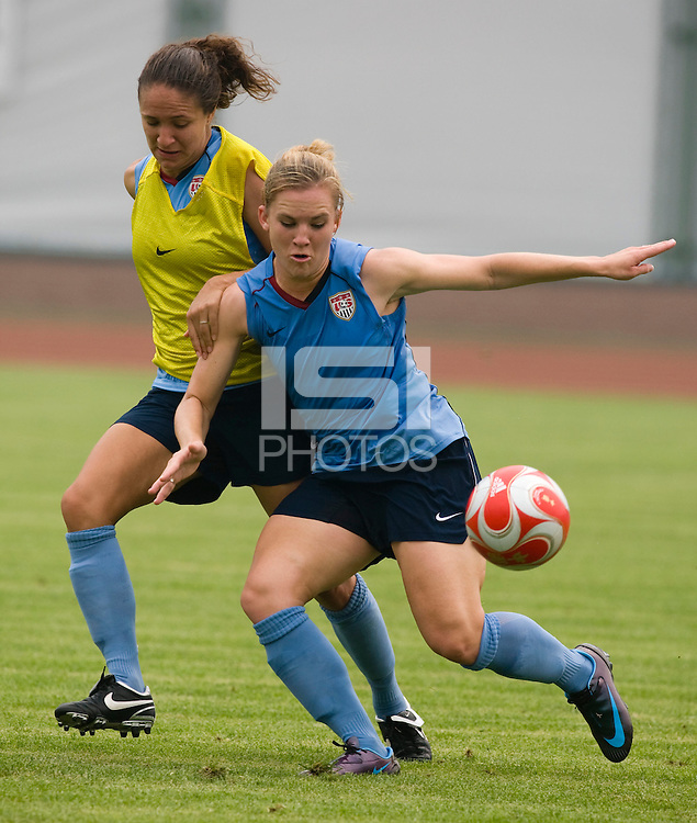 USWNT forward Amy Rodriguez tries to hold off defender Stephanie Cox  while practicing at Beijing Normal University in Beijing, China.  The team will now move to Qinhuangdao to prepare for their first two group games of the 2008 Olympics.