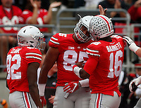 Ohio State Buckeyes tight end Marcus Baugh (85) celebrates touchdown with Ohio State Buckeyes wide receiver James Clark (82) and Ohio State Buckeyes quarterback J.T. Barrett (16)in the second quarter of the OSU Rutgers game at Ohio Stadium October 1, 2016.(Dispatch photo by Eric Albrecht)