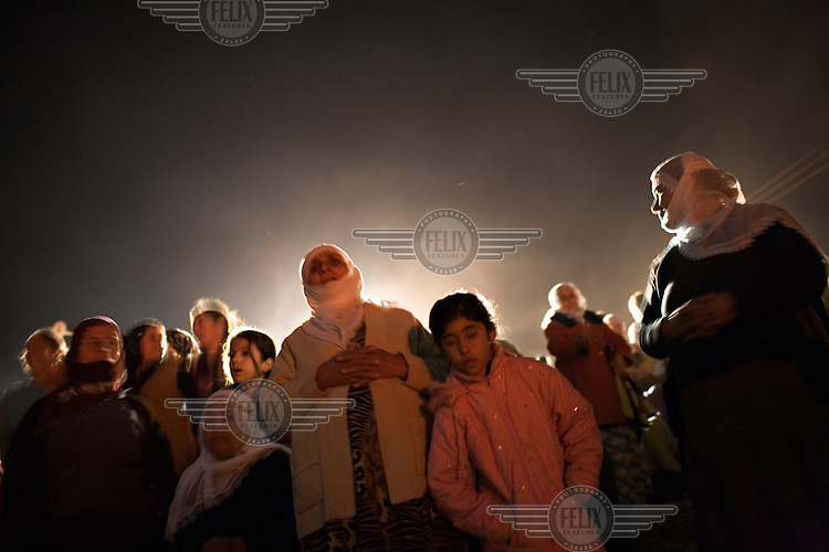 Kurdish women and children gather to watch illegal Newroz celebrations. Newroz is celebrated by Kurds throughout the country and is the celebration of the coming of spring. ...