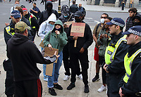 Black Lives Matter and left wing supporters argue with Police at boarded up Sir Winston Churchill statue in Westminster.<br /> Several of London's historic statues have been boarded up to protect them from being defaced or damaged during this weekend's expected protests in the capital. London, UK June 12th 2020<br /> <br /> Photo by Keith Mayhew