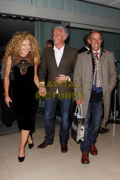 Kelly Hoppen, John Gardner and Ben de Lisi.Rodial Beautiful Awards, Sanderson Hotel, London, England..March 6th, 2012.full length black dress grey gray suit jacket white shirt jeans denim couple holding hands goody beige coat.CAP/AH.©Adam Houghton/Capital Pictures.