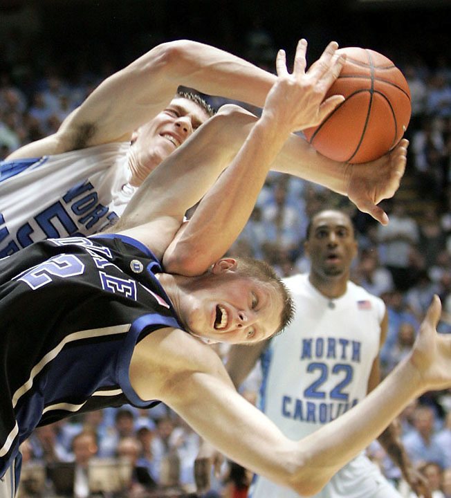 UNC's Tyler Hansbrough, top, fights for a rebound with Duke's Kyle Singler,during the second half of Duke's 89-78 win at the Smith Center in Chapel Hill, NC.  jkrsl