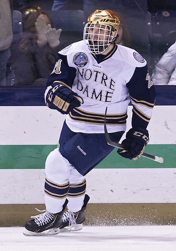 March 16, 2013:  Notre Dame right wing Bryan Rust (21) celebrates penalty shot goal during NCAA Hockey game action between the Notre Dame Fighting Irish and the Bowling Green Falcons at Compton Family Ice Arena in South Bend, Indiana.  Notre Dame defeated Bowling Green 4-3.
