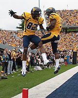 WVU wide receiver Alric Arnett (left) celebrates his touchdown with Jock Sanders. The WVU Mountaineers defeated the East Carolina Pirates 35-20 at Mountaineer Field at Milan Puskar Stadium, Morgantown, West Virginia on September 12, 2009.