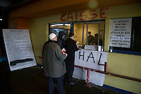 People line up at a temporary slaughterhouse set up in an hanger in Pantin, outside Paris, France, 1 February 2004, to pay for the sheep that will be slaughtered for them during the Muslim celebration of Aid-el-Kebir. Photo Credit: David Brabyn.