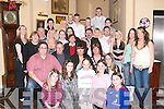 GATHERED: Louise Quirke of Killorglin (seated centre) who celebrated her 21st Birthday at the Abbey Gate Hotel, Tralee, on Saturday night with many of her family and friends..