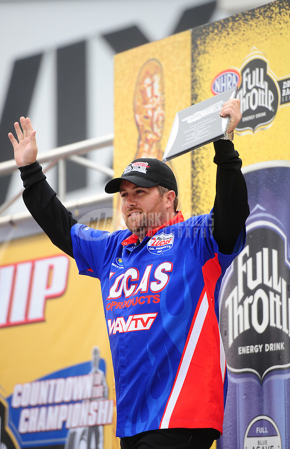 Sept. 16, 2011; Concord, NC, USA: NHRA top fuel dragster driver Shawn Langdon during qualifying for the O'Reilly Auto Parts Nationals at zMax Dragway. Mandatory Credit: Mark J. Rebilas-