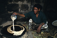 Farmer cooking Injera, the  national dish in Ethiopia made out of teff flour