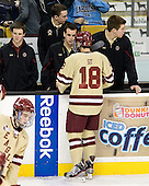 Chris Malloy (BC - Manager), Neal Ratto (BC - Manager), Tom Maguire (BC - Statistician), Michael Sit (BC - 18), Kevin Pratt (BC - Manager) - The Boston College Eagles defeated the Northeastern University Huskies 7-1 in the opening round of the 2012 Beanpot on Monday, February 6, 2012, at TD Garden in Boston, Massachusetts.