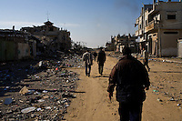 Rafah, Gaza Strip, Jan 12 2009.Civilians living in houses near de Philadelphia line (border with Egypt) that is being extensively boombed by the Israeli air force, are trying to salvage what they can from their damages homes. On the 16th day of the Israeli operation in Gaza, one and a half million people are still deprived of electricity and basic supplies, as well as being unable to flee from the densely populated combat zone.