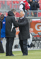 06 April 2013: Toronto FC head coach Ryan Nelsen shakes hands with FC Dallas head coach Schellas Hyndman at the end of an MLS game between FC Dallas and Toronto FC at BMO Field in Toronto, Ontario Canada..The game ended in a 2-2 draw..