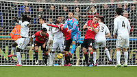 SWANSEA, WALES - FEBRUARY 21: The ball slips through the hands of goalkeeper Lukasz Fabianski of Swansea from a Manchester United shot during the Barclays Premier League match between Swansea City and Manchester United at Liberty Stadium on February 21, 2015 in Swansea, Wales.