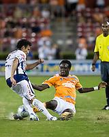 Houston Dynamo forward Kei Kamara (10) slide tackles Pachuca FC defender Leobardo Lopez (2).  Houston Dynamo defeated Pachuca FC 2-0 in the semifinals of the Superliga 2008 tournament at Robertson Stadium in Houston, TX on July 29, 2008.