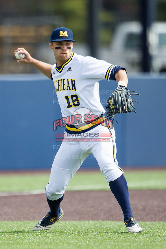 Michigan Wolverines third baseman Jake Bivens (18) makes a throw to first base against the Toledo Rockets on April 20, 2016 at Ray Fisher Stadium in Ann Arbor, Michigan. Michigan defeated Bowling Green 2-1. (Andrew Woolley/Four Seam Images)