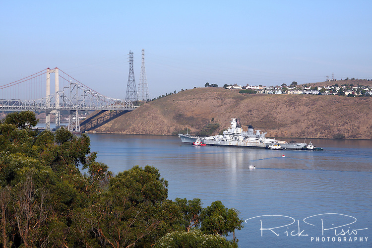 Tugboats move the battleship USS Iowa (BB61) through the Carquinez Straits on October 28, 2011 after being pulled from the Mothball Fleet in Suisun Bay.