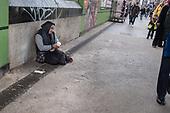 Woman begging in Whitechapel Market, London.