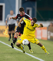 Chris Pontius (13) of D.C. United fights for the ball with Sebastian Miranda (21) of the Columbus Crew during the game at RFK Stadium in Washington, DC.  D.C. United defeated the Columbus Crew, 1-0.