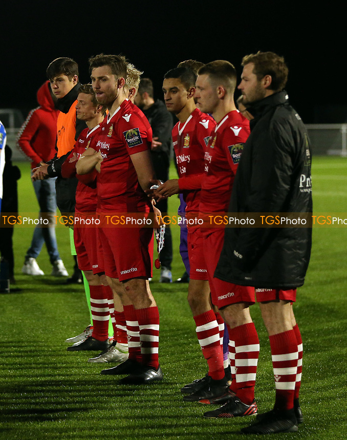 AFC Hornchurch players watch Enfield Town collect the trophy after AFC Hornchurch vs Enfield Town, Velocity Trophy Final Football at Parkside on 10th April 2019