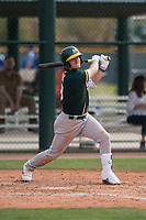 Oakland Athletics center fielder Austin Beck (18) follows through on his swing during a Minor League Spring Training game against the Chicago Cubs at Sloan Park on March 13, 2018 in Mesa, Arizona. (Zachary Lucy/Four Seam Images)