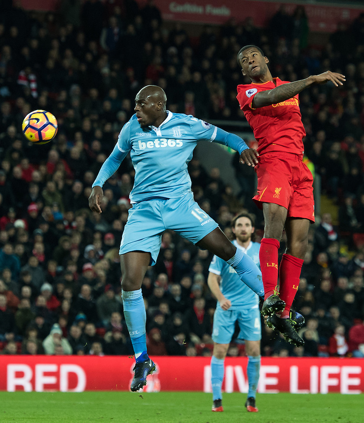 Liverpool's Georginio Wijnaldum wins the header from Stoke City's Bruno Martins Indi<br /> <br /> Photographer Terry Donnelly/CameraSport<br /> <br /> The Premier League - Liverpool v Stoke City - Tuesday 27th December 2016 - Anfield - Liverpool<br /> <br /> World Copyright &copy; 2016 CameraSport. All rights reserved. 43 Linden Ave. Countesthorpe. Leicester. England. LE8 5PG - Tel: +44 (0) 116 277 4147 - admin@camerasport.com - www.camerasport.com