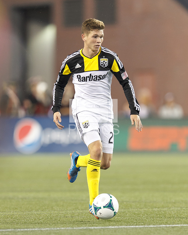 Columbus Crew midfielder Wil Trapp (20) brings the ball forward.  In a Major League Soccer (MLS) match, the New England Revolution (blue) defeated Columbus Crew (white), 3-2, at Gillette Stadium on October 19, 2013.