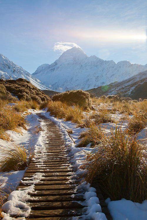 Snow covered boardwalk on the Hooker Valley track leading to Hooker Lake at Mt Cook / Aoraki, New Zealand - stock photo, canvas, fine art print