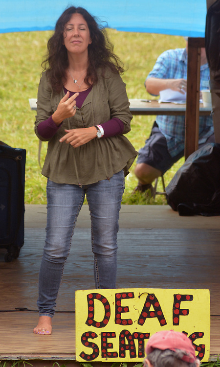 """Sign Language Interpretor seen """"Singing""""  with the """"Wake Me Shake Me"""" show on the Workshop Stage at the 29th Annual Falcon Ridge Folk Festival at Dodds Farm of N.Y. Route 22, north of Hillsdale,NY, on Saturday, August 5, 2017. Photo by Jim Peppler. Copyright/Jim Peppler-2017."""
