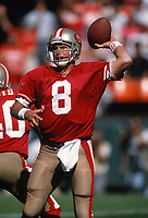 SAN FRANCISCO, CA:  Quarterback Steve Young of the San Francisco 49ers throws a pass during a game against the New England Patriots at Candlestick Park in San Francisco, California on September 17, 1995. (Photo by Brad Mangin)