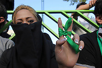 A young woman wearing green, the colour of the opposition. An estimated one million people formed a human chain along Vali asr Avenue, the longest street in Tehran. Following a disputed election result, thousands of supporters of opposition candidate Mir-Hossein Mousavi took to the streets in protest.