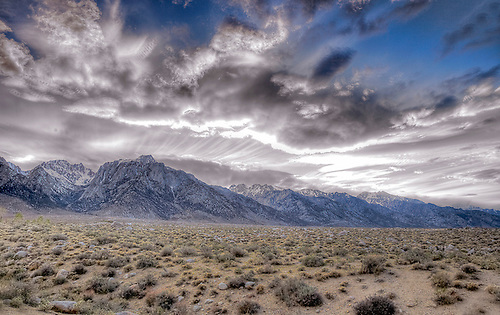 A DRAMATIC SKY DOMINATES THE LANDSCAPE IN THE OWENS VALLEY AND EASTERN SIERRA MOUNTAINS