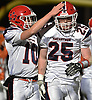 Hugh Kelleher #25 of MacArthur, right, gets congratulated by quarterback Matt Cummings #10 after rushing for a touchdown in the second quarter of the Nassau County football Conference II semifinals against Carey at Shuart Stadium, located on the campus of Hofstra University in Hempstead, on Thursday, Nov. 8, 2018.