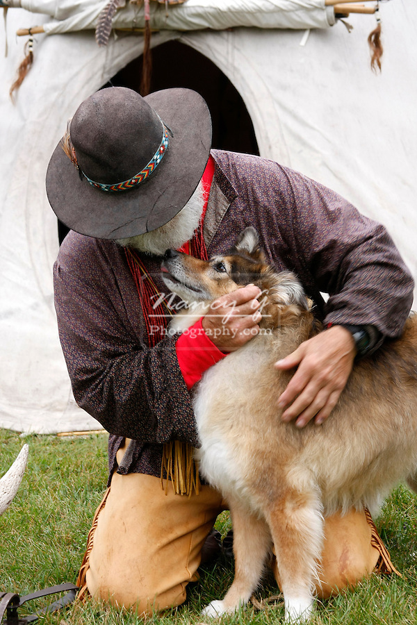 A mountainman greeting his dog