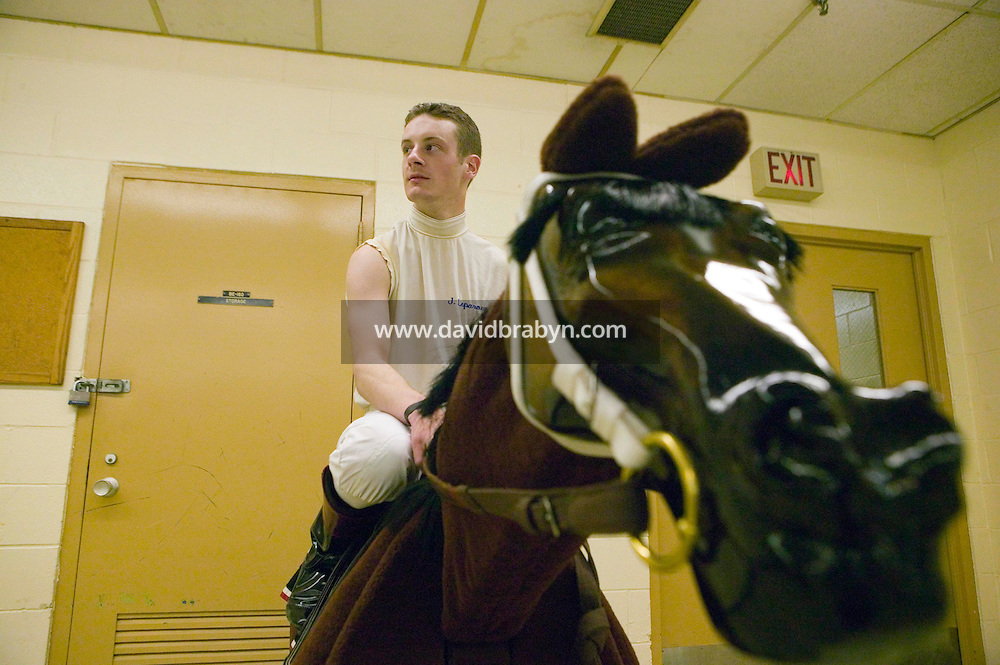 27 May 2006 - ELMONT, NY - 22 year-old French apprentice jockey Julien Leparoux pauses from warming up on a wooden training horse in the jockeys' room at Belmont Park hippodrome in Elmont, outside New York City, USA, 27 May 2006.