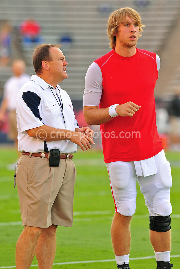 Sept 11, 2010; Tucson, AZ, USA; Arizona Wildcats quarterbacks coach Frank Scelfo talks with quarterback Nick Foles (8) prior to a game against the Citadel Bulldogs at Arizona Stadium.  Arizona won the game 52-6.