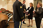 "April 16, 2014. Durham, North Carolina.<br />  Senator Kay Hagan, center, spoke with military personnel after an event to award a posthumous Bronze Star at a local retirement community. Hagan has been largely absent from the campaign trail even as several Republican challengers have mounted campaigns to defeat her in this year's election.<br />  Kay Hagan (D),  US Senator from North Carolina, attended an event to honor the military service of Donald ""Buddy"" Moore, Hagan awarded Moore's widow Wanda a posthumous Bronze Star, as well as several other medals, for his service in World War II."