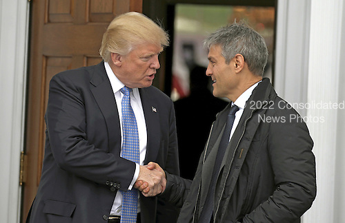 United States President-elect Donald Trump (L) shakes hands with Ari Emanuel at the clubhouse of Trump International Golf Club, in Bedminster Township, New Jersey, USA, 20 November 2016.<br /> Credit: Peter Foley / Pool via CNP