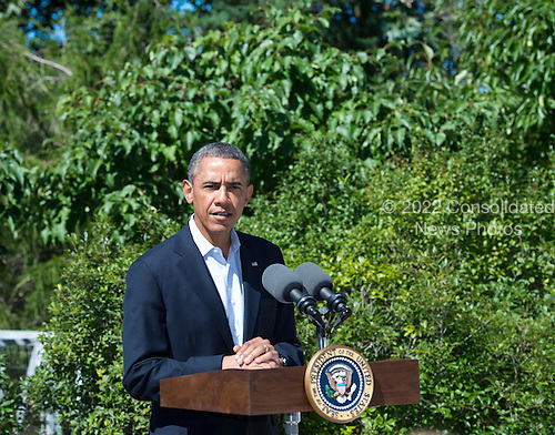 United States President Barack Obama makes a statement on the situation in Egypt from the driveway of his vacation house in Chilmark, Massachusetts on the island of Martha's Vineyard, Massachusetts on Thursday, August 15, 2013<br /> Credit: Rick Friedman / Pool via CNP
