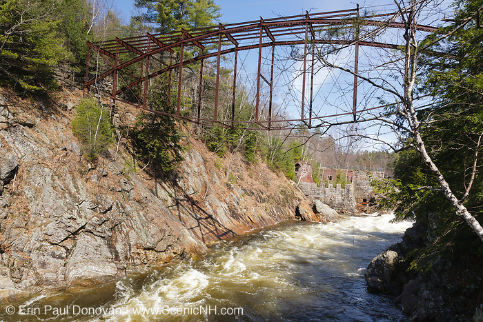 "Remnants of the ""Pumpkin Seed Bridge"" at Livermore Falls in Campton, New Hampshire. This bridge was erected in 1886 by the Berlin Iron Bridge Company and crossed the Pemigewasset River. It is 263 feet long and closed 1959."