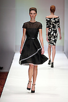 HOUSTON, TX - NOVEMBER 14 : Model walks the runway during a Kevan Hall show on day three of Fashion Houston Spring 2013 Presented By Audi at the Wortham Theatre Center on November 14, 2012 in Houston, Texas. (Photo by Louis Dollagaray/MediaPunch inc) NortePhoto