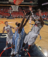 Virginia forward Akil Mitchell (25) shoots over North Carolina forward James Michael McAdoo (43) during an NCAA basketball game against Virginia Monday Jan. 20, 2014 in Charlottesville, VA. Virginia defeated North Carolina 76-61.