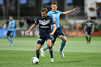17th November 2019; Jubilee Oval, Sydney, New South Wales, Australia; A League Football, Sydney Football Club versus Melbourne Victory; Jakob Poulsen of Melbourne Victory shields the ball from Brandon O'Neill of Sydney