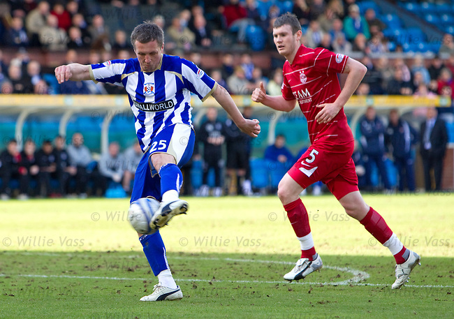 Scott Severin volleys home to score for Kilmarnock as the ball goes in off Aberdeen defernder Davide Grassi