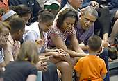 United States President Barack Obama, first lady Michelle Obama and daughters Malia Obama and Sasha Obama attend the Hawaiian Airlines Diamond Head Classic men's basketball game between the Oregon State Beavers and the University of Akron Zips at the University of Hawaii at Manoa Stan Sheriff Center, Sunday, December 22, 2013. The first lady's brother, Craig Robinson, is the Oregon State University Men's Head Basketball Coach.  <br /> Credit: Cory Lum / Pool via CNP