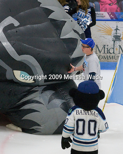 Fixing the inflated Black Bear which fell over prior to the players coming out through it. - The Boston College Eagles and University of Maine Black Bears tied 3-3 (OT) on Saturday, November 21, 2009, at Alfond Arena in Orono, Maine.