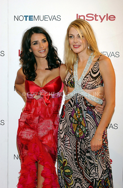 """Penelope Cruz and Claudia Gerini at the premiere of """"No Te Muevas"""" at the Callao Cinema in Madrid - 16 September 2004..FAMOUS.PICTURES AND FEATURES AGENCY.tel  +44 (0) 20 7731 9333.fax +44 (0) 20 7731 9330.e-mail info@famous.uk.com.www.famous.uk.com.FAM13561"""