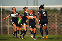 Sky Blue FC forward Lisa De Vanna (11) celebrates scoring with teammates. Sky Blue FC defeated the Boston Breakers 5-1 during a National Women's Soccer League (NWSL) match at Yurcak Field in Piscataway, NJ, on June 1, 2013.