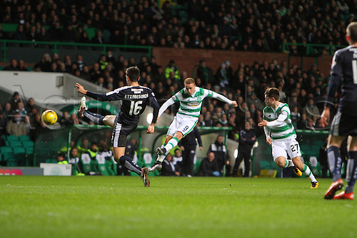 02.03.2016. Celtic Park, Glasgow, Scotland. Scottish Premier League. Celtic versus Dundee. Leigh Griffiths fires in a shot past the defending Etxabeguren of Dundess