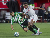 11th June 2020, Sevilla, Spain;  La Liga Spanish football league. Sevilla FC versus Real Betis. Resumption of football matches in Spain after three months postponed by the global pandemic of COVID-19. Game was played without any fans in the stadium and with  strict sanitary measures.. Fernando Reges (Sevilla FC) and Fekir (Real Betis). |