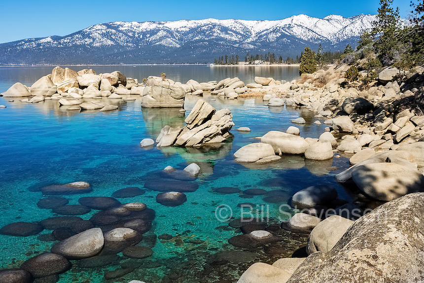 An image of the clear water on the east shore of Lake Tahoe in Nevada, This cove contains Bonsai Rock, an icon of Lake Tahoe.