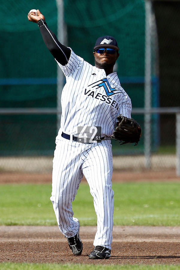 03 September 2011: Mervin Gario of the Vaessen Pioniers throws to first base during game 1 of the 2011 Holland Series won 5-4 in inning number 14 by L&D Amsterdam Pirates over Vaessen Pioniers, in Hoofddorp, Netherlands.